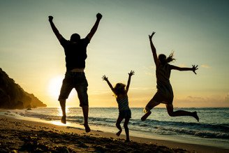 Joyous-family-jumping-by-the-seaside
