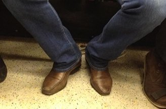 Men's brown shoes with blue jeans