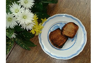 Two pieces of toast on a plate with flowers