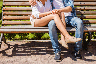 Woman and man on bench, Are You Dating A Player DDM Matchmaker blog